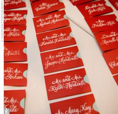 aqua cards set in small red envelopes with the guests' names written in white.