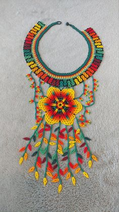 This is described as the rainfall because of the details in the beading having a cascading effect. Flower Necklace, Crochet Necklace, Beaded Necklace, African Crafts, Beaded Crafts, Jewelry Making Tutorials, Animal Design, Easy Crochet, Paper Flowers
