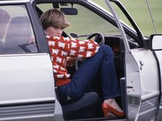 Sitting in her car sporting a checkered sweater while attending a polo match.  - GoodHousekeeping.com