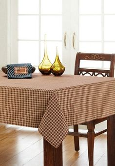 "Dress your table up with our Patriotic Patch Table Cloth 60x60"" and protect it at the same time. Add your favorite centerpiece and dishes. https://www.primitivestarquiltshop.com/products/patriotic-patch-table-cloth-60x60 #primitivekitchensdiningrooms"