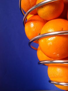 Orange and blue - no wonder so many athletic teams have those colors:  they are strong.  Subtle silver is a good, soft contrast for a background color.