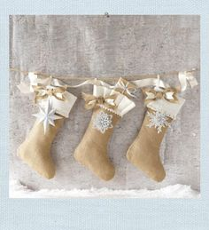 Burlap Stocking. A warm welcome for Christmas treats hang from the mantel with care. Burlap stocking includes silver ornament which you may leave on as an adornment or detach and hang on the tree or use as a package accent.