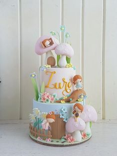 Looking for baby shower cakes but unsure about where to start? This post has tons of beautiful cake examples plus helpful tips on how to choose your own. Fairy Garden Cake, Garden Cakes, Fairy Birthday Cake, Birthday Cake Girls, Girly Cakes, Cute Cakes, Yummy Cakes, Fondant Cakes, Cupcake Cakes