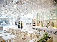 Coutume-cafe-Aoyama-in-Tokyo-Japan-by-CUT-Architectures A white-lacquered steel ceiling grid, plants under strips of lighting and white tiled surfaces feature in this Tokyo cafe, designed by CUT Architectures to resemble a laboratory.