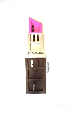 Mac lipstick wall display/holder.