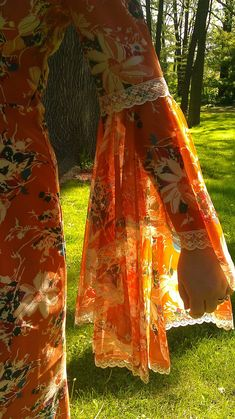 This reminds me of the butterfly shirts from the 70's.  Used to feel like a princess wearing one.  :)  Bell Sleeve- hippy gorgeous