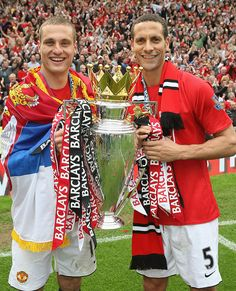 Nemanja Vidic and Rio Ferdinand of Manchester United celebrate with the Premier League trophy after the Barclays Premier League match between Manchester United and Arsenal at Old Trafford on May Get premium, high resolution news photos at Getty Images Manchester United Champions, Manchester United Legends, Manchester England, Manchester United Football, Legends Football, Best Football Team, Football Players, Man Utd Fc, Rio Ferdinand
