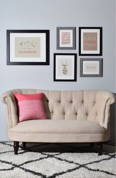 Absolutely adoring this gallery wall that includes a set of five prints that mix-and-match to create a charming touch in the living room.