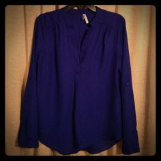 Long sleeve blouse Beautiful blue long sleeve blouse. The sleeves can be buttoned and rolled up to make it a 3 1/4 length. It is a smooth, sheer, free flowing material. Truth Tops Blouses