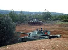 Hellenic Army Leopard 1A5 and M48A5 MOLF, outta way.