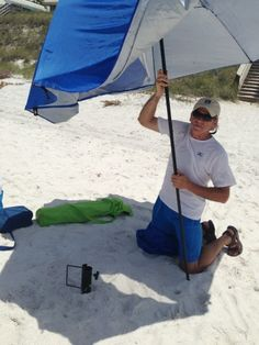 A Heavy Duty Metal Beach Umbrella Stand Secures The Pole So It Stays Stable And Secure