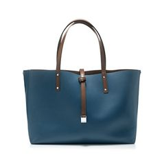 Tiffany Reversible Tote in Florentine Blue/Espresso. Smooth leather with palladium-plated solid brass hardware. Detachable zipper pouch included. Leather tab closure. Double strap. More colors available.