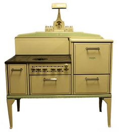 Believe it or not, this is the exact model stove we had growing up. I learned to cook on this. You had to light a match to get it going and I almost burnt down the house. I wonder what we ever did with this - its really beautiful.