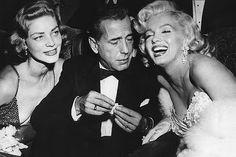Lauren Bacall, Humphrey Bogart & Marilyn Monroe.