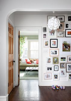 source: The New York Times website Fun entryway with white walls adorned with a gallery wall of family photographs. A modern white pendant hangs over… – Flooring Designs Beautiful Houses Interior, Beautiful Homes, Inspiration Wall, Interior Inspiration, Sweet Home, Appartement Design, Up House, Dream Decor, Home Fashion