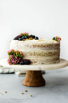 This pistachio cake is made with real pistachios! It's soft, fluffy, light and tastes unbelievable with silky cream cheese frosting. Make this layer cake for your Easter dessert! Sweet Recipes, Cake Recipes, Dessert Recipes, Delicious Recipes, Mini Cakes, Cupcake Cakes, Food Cakes, Naked Cakes, Pistachio Cake
