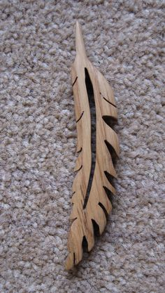 "Heavy grained wood, scroll saw middle, maybe scroll feather edges, #2 to give a slight curve ""("" esqe and a 45 degree vertical twist."