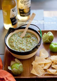 Toss tomatillos, garlic, and jalapeno with olive oil and roast until tomatillos are browned and blistered. Then process with olives, cilantro, lime and sugar, and serve as a sauce or chip dip.