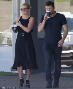 Lara Bingle was seen looking chic in a black dress and sky-high heels as she enjoyed a low-key outing with Sam Worthington in Perth, Australia.  (December 31, 2013)