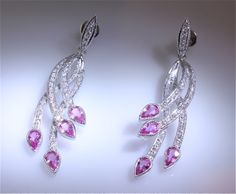Unique Chateau earrings; pink tear drop stones set on tips