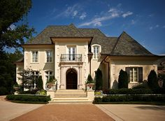 The tradition of classically detailed homes that are custom tailored to their surroundings and the clients' way of living