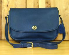 This is an original Coach bag in the iconic City style. This particular bag comes in a hard-to-find indigo/navy blue color. Features:  • Indigo/navy