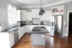 Bower Power Kitchen Remodel:  Wall color:  Benjamin Moore - Metropolitan - A stylish gray with cool blue undertones, metropolitan reflects the modern sophistication of 21st-century urban spaces. Gorgeous against the tile and white cabinets.  So lovely~~~