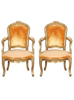 A pair of Louis XV child-size giltwood fauteuils with cabriole legs and floral…