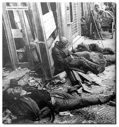 Battle of Berlin, April 1945: Dead and half dead lie together in the streets.