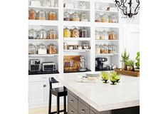 If this much open shelving is wrong, we don't want to be right! Just give us a few dozen Anchor-Hawking Heritage jars and even the dried apricots and cereal look display-worthy! via @purewow.com
