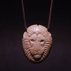 Hey, I found this really awesome Etsy listing at https://www.etsy.com/listing/596454537/lion-necklace-river-stone-hand-carved-by