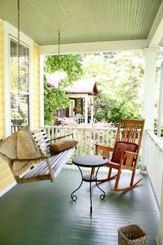 A welcoming covered porch with plenty of room to sit and visit on a quiet street.