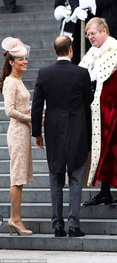 The Duchess of Cambridge wore a nude-coloured Alexander McQueen dress and Jane Taylor hat as she and William were met by the Lord Mayor of London``