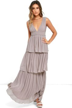 Dancing in the Gently Adrift Taupe Maxi Dress is an absolute dream! A sleeveless bodice, with plunging V-neckline, tucks into a banded waist above a tiered maxi skirt, composed of accordion pleated, woven poly. Back slit buttons at top. Hidden back zipper/hook clasp.