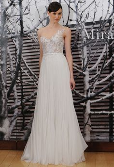 Asymmetric embroidered A-line wedding dress by Mira Zwillinger | Hottest Dresses from New York Bridal Fashion Week Spring 2015