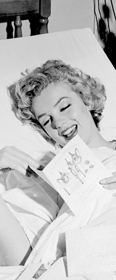 Marilyn reading a get well card after an operation for an appendectomy, May 1952.