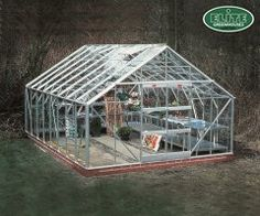 Elite Classique 12x10 Greenhouse with Horticultural Glazing. These large 12ft wide greenhouses from Elite give the serious grower a superb space complete with roof and louvre vents and a large 8ft aluminium shelf. With prices for a 12ft x 10ft model starting at £948.00 from Greenhouse Stores with FREE UK delivery. http://www.greenhousestores.co.uk/Elite-Classique-Greenhouse/