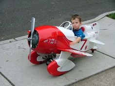 GeeBee Pedal plane - This KID will grow up to to be a real HELL raiser. He's already piloting a racing plane...