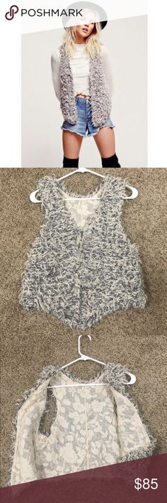 Free people shrug vest Worn like maybe 5 times, great condition. Gray and white shrug like vest. Clips in the front of you want to clothes it. Can be worn in summer like an outfit as the model or of course in winter with a long sleeve, leggings and boots. Such a fun piece! It's not suppose to be reversible but honestly I wore it flipped over even says it has a floral type nude pattern! Free People Jackets & Coats Vests