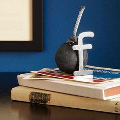 Fred Conlon's recycled steel F Bomb Paperweight lightens up desk-side chats and tough conversations.
