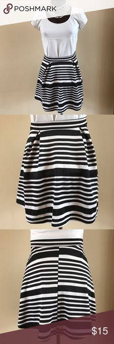 """NWT SKATER SKIRT From Wet Seal, this NWT skater skirt is perfect for the upcoming season. Pull on, 1.5"""" thick waistband, front pleats. 95% polyester and 5% spandex for hold and comfort. Machine washable. Size Junior Medium. Measures approx 13.5"""" waist and 16.5"""" overall length. Wet Seal Skirts Circle & Skater"""