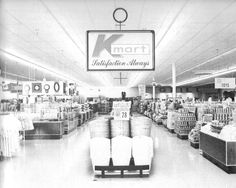 Looking down the center aisle of a typical 1970's K mart.