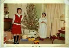 1960 from left to right ,Becky (Broghammer) Roberts .  Dolly (Carey) Panos at our old house on Boody St. Ossian,Ia.