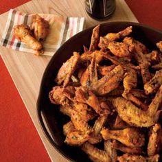 """These crispy chicken wings get their heat from Sriracha, the Thai hot sauce that chef Michael Symon says is his favorite in the world. """"We always have a couple of extra bottles at home, because my stepson blows right through the stuff."""""""