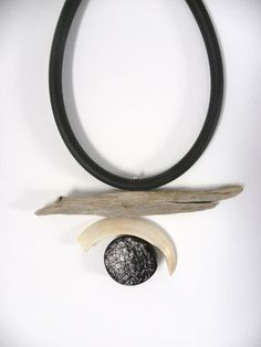Eliane Amalric  - Wood float collar, warthog tooth, resin rubber disk