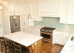 white countertops and wooden island