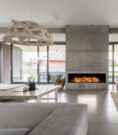 The concrete Design of betonstuc for a cool, rugged finish to your walls and floors. It's on the wall by the fireplace. Beton Design, Concrete Design, Victorian Living Room, Rustic Industrial Decor, Concrete Houses, Interior Decorating, Interior Design, Fireplace Design, Little Houses