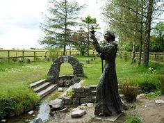 Brigid of Kildare; Healing well in Ireland.  There are two sections that you can go to; one as you see here next to the statue of Brigid, and one at the end of the path of stones that you see in the center of the picture.