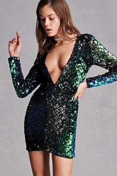 A knit bodycon dress  featuring a sequin design, a plunging V-neckline, and long sleeves. This is an independent brand and not a Forever 21 branded item.
