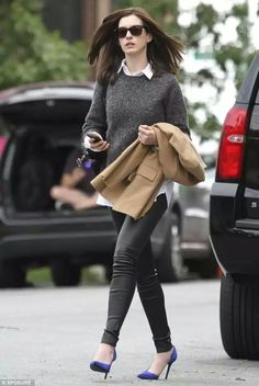 Anne Hathaway wearing leather pants
